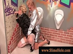 Two posh women hosed down by gloryhole